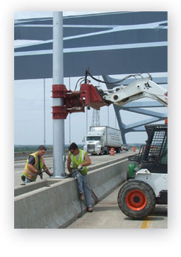 outdoor light pole installation on Leo Frigo Bridge